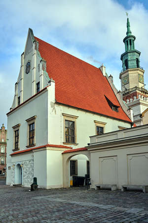 Historic building with red roofs and tower town hall on the market square in the city of Poznan