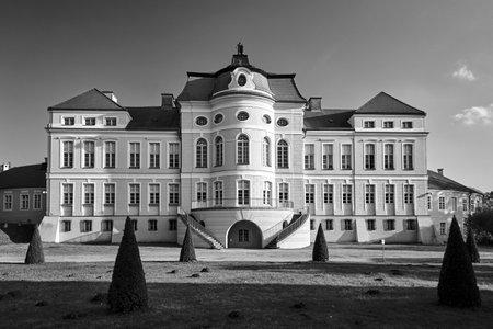 facade of the baroque palace and garden during autumn in Rogalin, monochrome