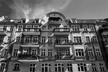 Facades with balconies of historic tenement houses in the city of Poznan, monochrome Editorial