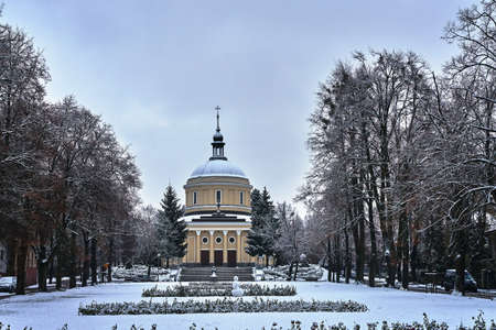 Square in front of the historic parish church during winter in Poznan Stock Photo