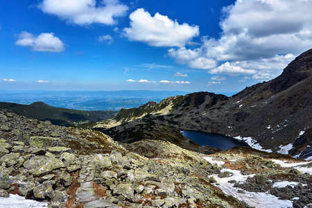 Glacial lake and rocky peaks in the Tatra Mountains in Poland