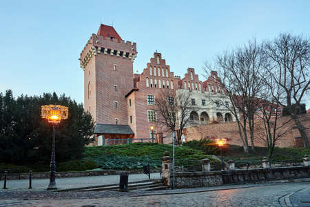 red brick tower reconstructed royal castle in the evening in Poznan