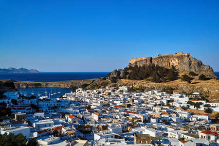 Medieval fortress and white houses of Lindos village in Rhodes, Greece
