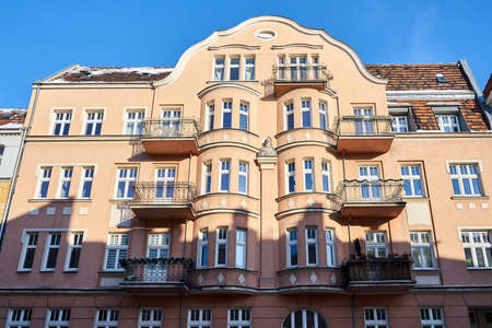 Facades with balconies of historic tenement houses in the city of Poznan Stock Photo
