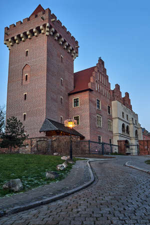 Red brick tower reconstructed royal castle in the evening in Poznan Editorial