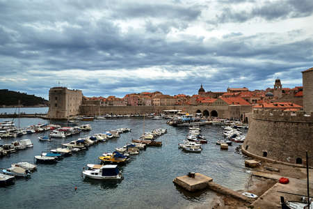 Medieval city walls and yacht harbor in the city of Dubrovnik, Croatia Editorial