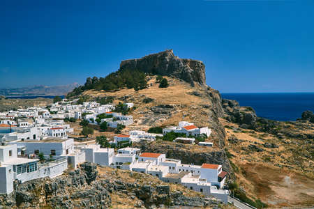 Medieval fortress and white houses of Lindos village in Rhodes Editorial