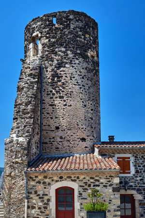 Stone medieval tower and historic buildings in the city of Saint-Vincent in France