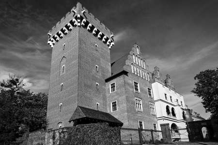 red brick tower reconstructed royal castle in Poznan, monochrome