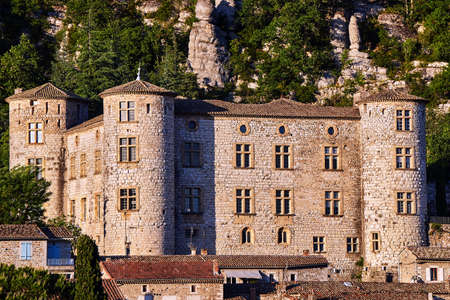 Stone castle and rocks in the medieval town of Vogue in France