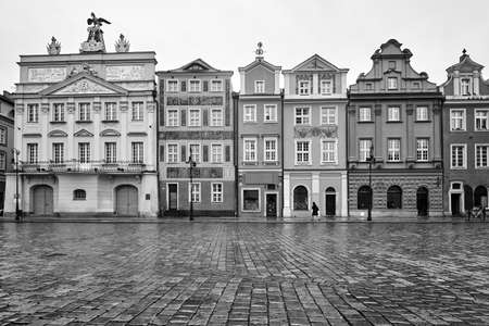 facades of historic tenements on the Old Market Square in Poznan, monochrome