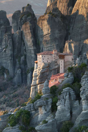 meteora: View of the Roussanou monastery and the rocks from above at sunset, Meteora, Greece