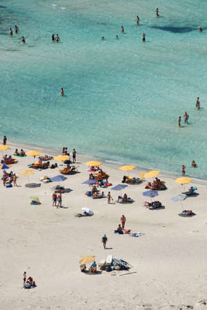 People relaxing at the beach in the famous Balos lagoon, Crete, Greece photo