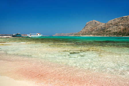 Famous beach with the pink sand and clear water at the Balos lagoon, Crete, Grece photo
