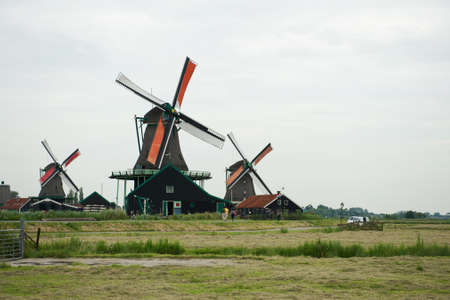 Traditional windmills and the field at the Zaanse Schans Stock Photo - 14319311