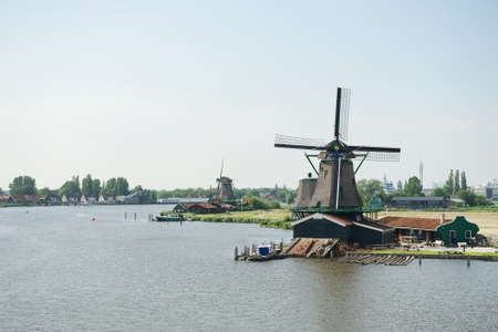 famous industries: View of the traditional windmills near the river, Zaanse Schans, Netherlands Stock Photo