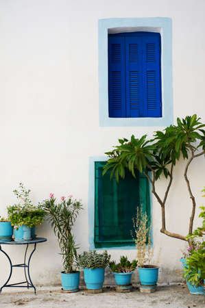 poros: Wall with colored windows from a traditional Greek house in Poros island