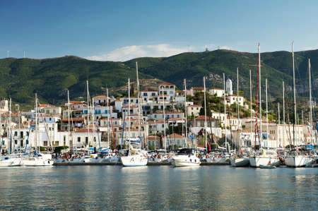 poros: View of the Poros island, boats, village and hills behind from the sea