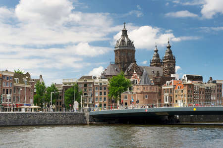 View of the historical center of Amsterdam and St. Nicolas Church in Amsterdam, the Netherlands photo