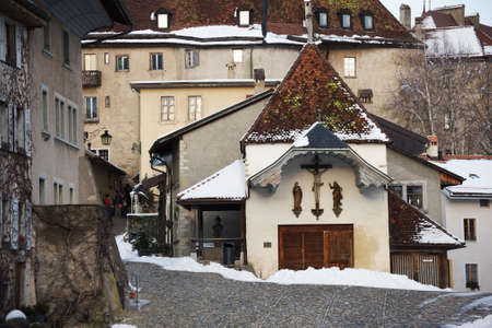 gruyere: Small church in the Gruyere village in winter, Switzerland