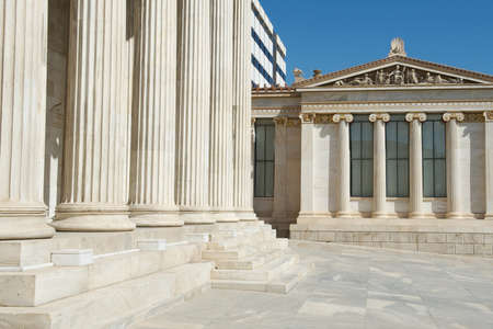 Mixture of classic  columns  and modern  building behind  architecture at Athens University, Greece