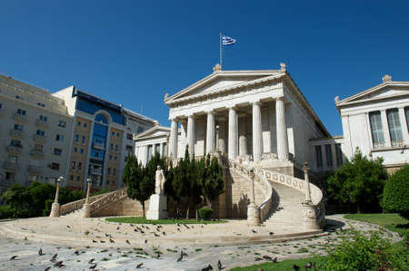 View of the National Library of Greece with the stairs and statue with modern building behind