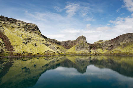 crater highlands: Still lake in a crater with reflections, Lakagigar, Iceland