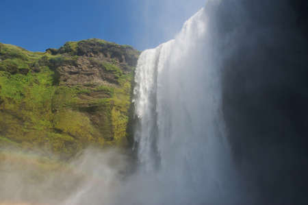 Falling waters of Skogafoss waterfall from below, South Iceland photo