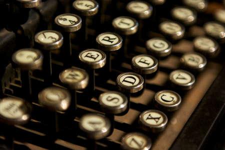 old macro: Close up photo of bronze vintage typewriter keys
