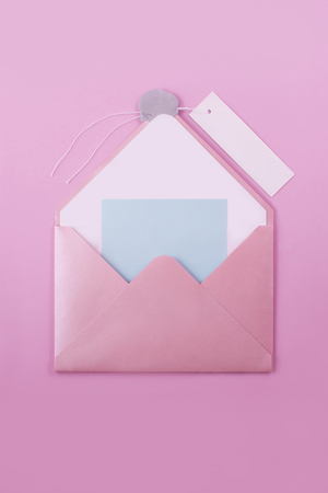pink open envelope letter with a wax seal and a paper label for signing on