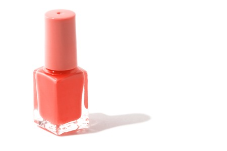 Trend photography on the theme of the color of the year 2019 - Living Coral. Isolated purple nail bottle on a white background with a place for the inscription. 写真素材