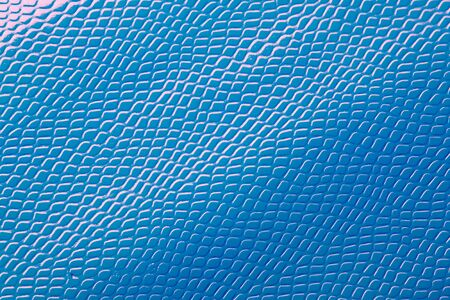 Light bright blue natural leather skin texture. 免版税图像