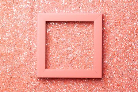 Photography on the theme of the trend color. Orange frame for a photo or inscription on a shiny glitter background. Banco de Imagens