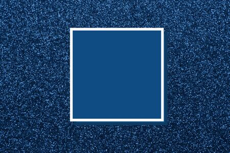 Photography on the theme of the trend color 2020. Abstract glitter dark blue background.