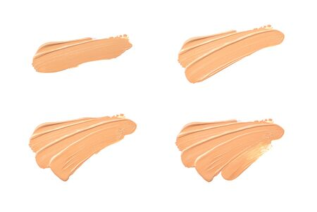 Group smear of foundation in the form diagonal strokes isolated on a white background.