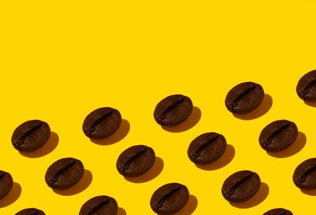 Creative bright collage of real macro photos of selected coffee beans on a yellow background with a place for inscription.