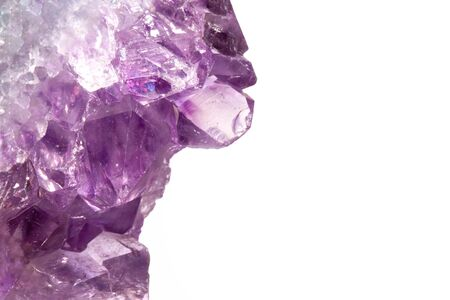 Real macro photo of amethyst natural crystal. Side view. Place for an inscription. Isolated on white background. Reklamní fotografie