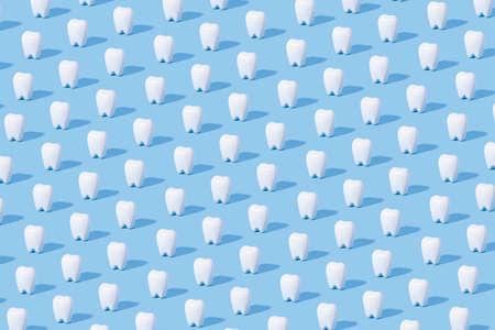 White teeth pattern on a blue paper background. 免版税图像