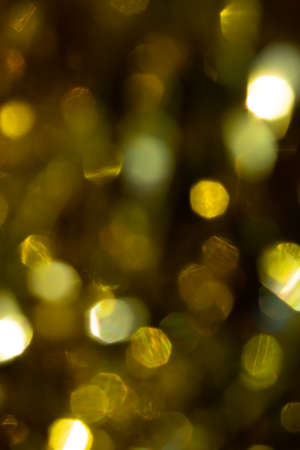 Abstract blurred gold background with beautiful bokeh effect. 免版税图像