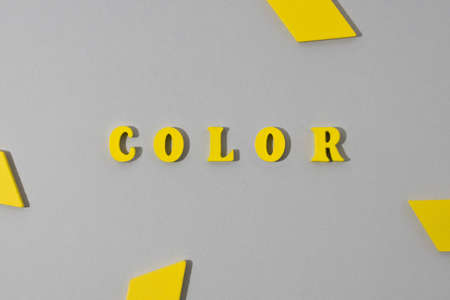 Abstract paper gray background with yellow wooden word.