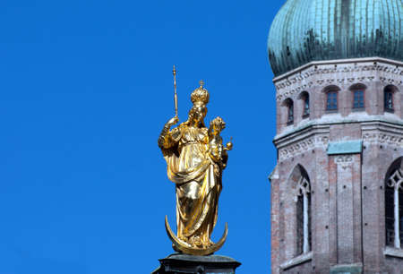 sceptre: Golden madonna in front of the frauenkirche in munich  Stock Photo