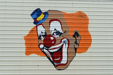 waggon: a clown laughs of a waggon