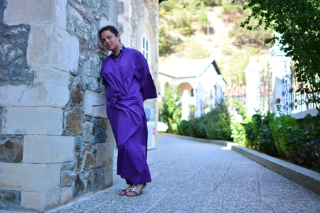 Brunette girl in a medieval suit in a Cyprus Medieval Monastery background Zdjęcie Seryjne