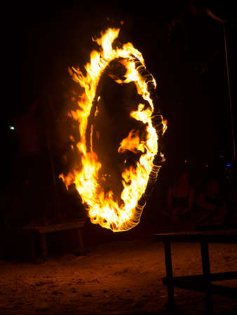 PHI PHI ISLAND, KRABI,THAILAND-MARCH 10,2020 : Amazing Fire Show at night on Phi Phi Island in Krabi Thailand. Publikacyjne