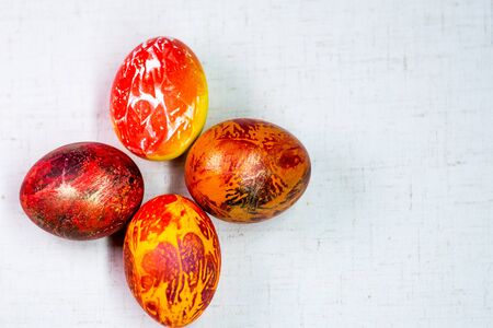 Painted in different colors Easter eggs on a white background Stock Photo