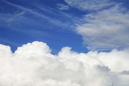 Sky-blue over white clouds in summer day