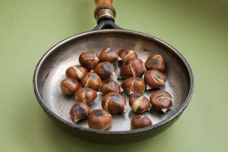 fryingpan: Fried chestnut on a frying-pan