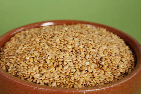 Ceramic bowl with brown flax seed ( lineseed ) Stock Photo - 8411106