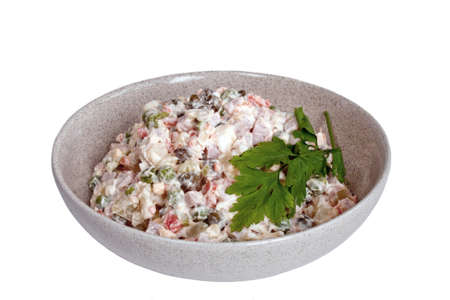 russian food: Traditional russian salad olivier in bowl on white background Stock Photo