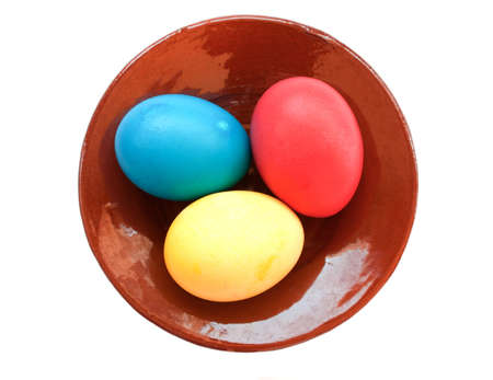 laying egg: Easter eggs on ceramic plate over white Stock Photo